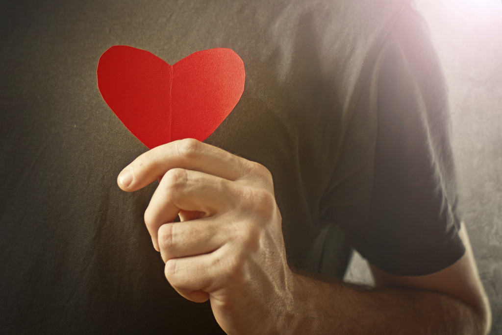 person holding cut out heart